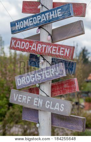 Signpost in a shopping street near Hoenderloo