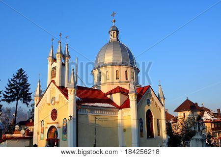 Orthodox church Saint Nicolas. Typical winter urban landscape of the city Brasov, a town situated in Transylvania, Romania, in the center of the country. 300.000 inhabitants.