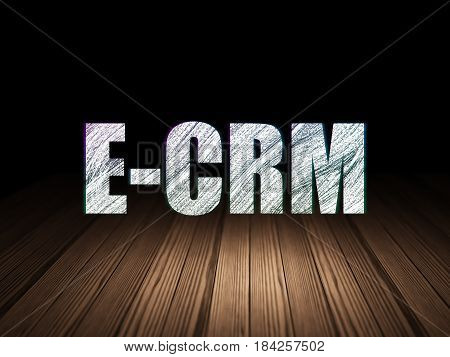 Business concept: Glowing text E-CRM in grunge dark room with Wooden Floor, black background