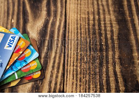 debit and credit cards on wooden background