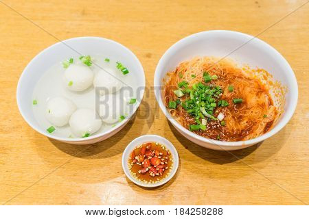 Teowchew Fishball Noodles With Soup And Chili Sauce On Table