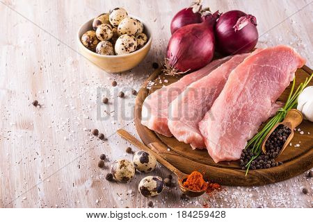 Raw Pork Meat With Few Spices And Quail Eggs
