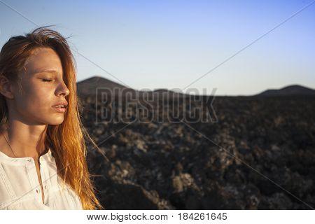 Breathtaking portrait of redhead woman in white dress.