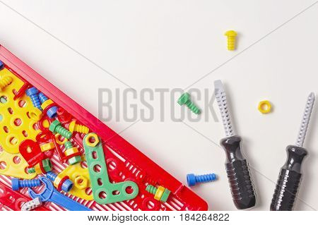 Toys background. Kids toy tool kit for education on white background. Top view. Flat lay. Copy space for text