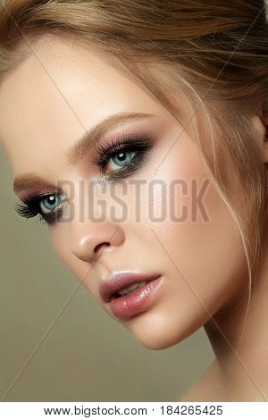 Beauty Portrait Of Young Woman With Classic Makeup