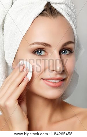 Portrait Of Young Beautiful Woman Cleaning Her Face