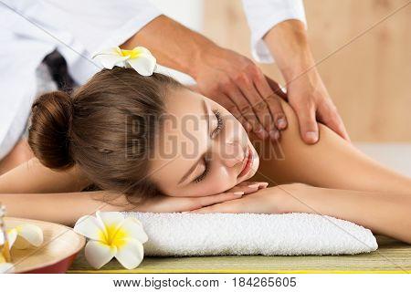 Beautiful Young Woman Laying At Spa Salon