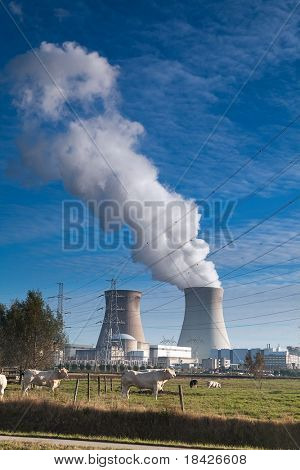cooling towers of a nuclear power plant atomic energy cooling towers white smoke and blue sky