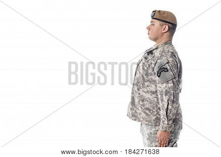 Army Ranger from Special Troops Battalion in universal Camouflage pattern Uniforms and Tan beret with Ranger Regiment crest is standing to attention. National holidays Veterans Day, Memorial Day. National Anthem is played poster
