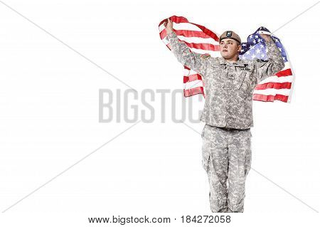 Army Ranger from Special Troops Battalion in universal Camouflage pattern Uniforms and Tan beret with Ranger Regiment crest standing and holding waving US flag in his hands proudly. National holidays: Veterans Day, Memorial Day poster