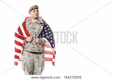 Army Ranger from Special Troops Battalion in universal Camouflage pattern Uniforms and Tan beret with Ranger Regiment crest standing weraing US flag on his shoulders. National holidays: Veterans Day, Memorial Day poster