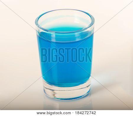 Single Glass Of Blue Drink Kamikaze, Thick Glass, Closeup, Blue Shot