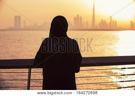 Arabic woman in love with the view of Dubai