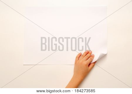 Child's Hand Turning Over Paper