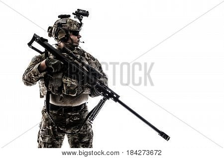Army Ranger in field Uniforms with sniper rifle, plate carrier and combat helmet are on, his face closed by Shemagh Kufiya scarf. Studio shot