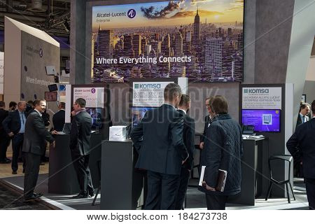 Hannover Germany - March 22 2017: Booth of the company Alcatel Lucent with business men at CeBIT 2017. CeBIT is the world's largest trade fair for information technology.