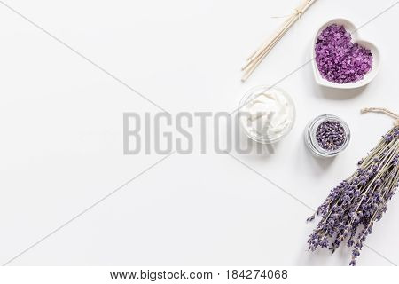 lavender herbs in body care cosmetics on white table background top view space for text