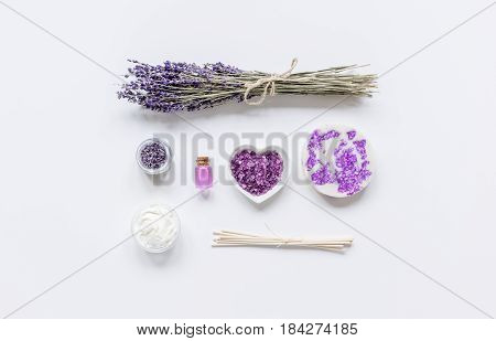 natural herb cosmetic with lavender flowers flatlay on white table background top view mockup