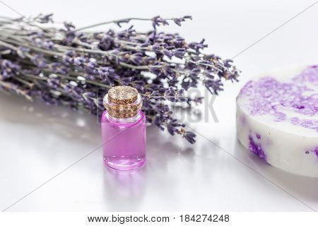 lavender herbs in body care cosmetics with aroma oil on white table background