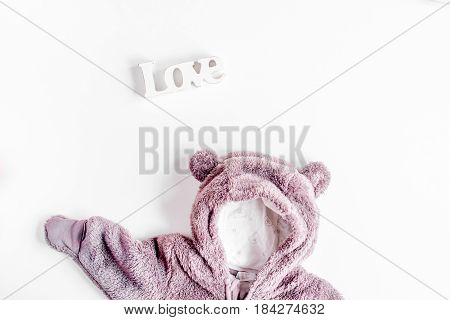 Baby clothes and toys set on white background top view mock up