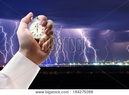 Night Thunder Lightning And Stopwatch In Male Hand
