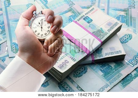 Money And Stopwatch In Male Hand