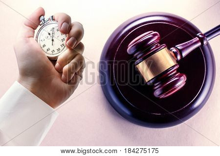 Wooden Gavel And Stopwatch In Male Hand