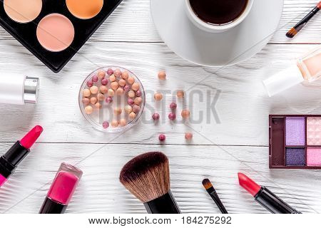 cosmetics composition with coffee and lavender flowers on white woman desk background top view