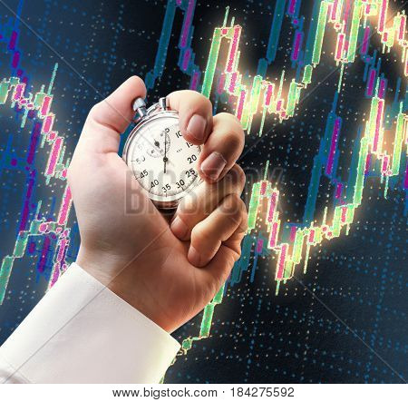 Candlestick Chart And Stopwatch In Male Hand