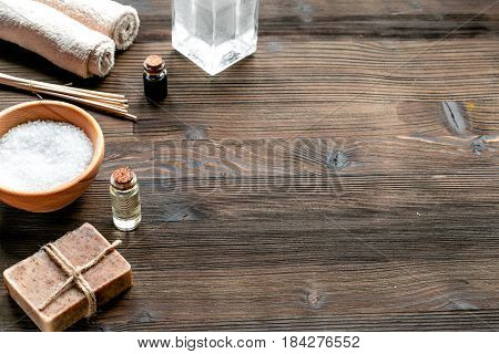 spa set with towels and organic soap on wooden table background mock up