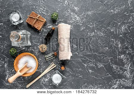 Aromatherapy SPA set with salt and natural oil on dark background top view mockup