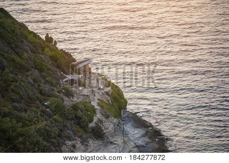 morning and fisher home on mountain with sea