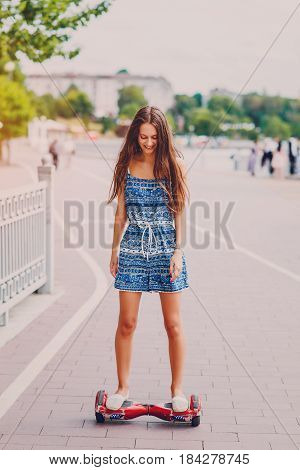 Beautiful girl is walking around the city and admire good location