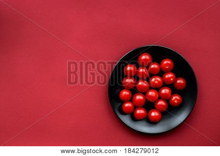 romantic dinner in red color with cherry tomatoes in black plate top view mockup