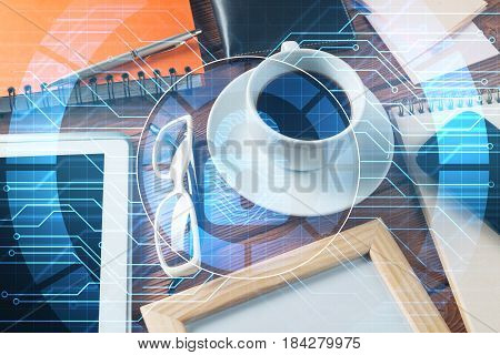 Tablet coffee cup and other office stuff on wooden table