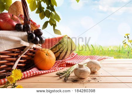 Picnic Wicker Basket With Food In The Field Blue Background