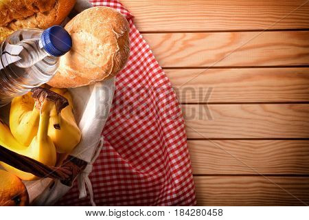 Picnic Wicker Basket With Food On Wood Table Top View