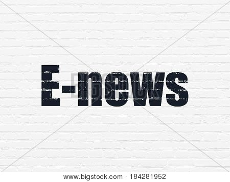 News concept: Painted black text E-news on White Brick wall background