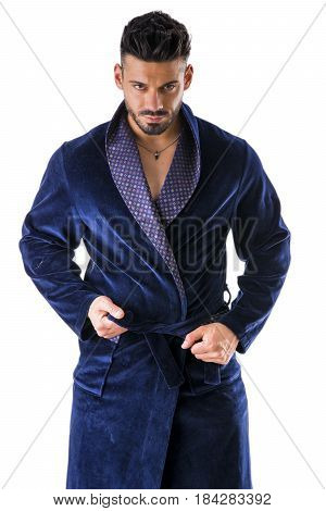 Handsome muscular male in bathrobe or nightrobe undressing, isolated on white background.