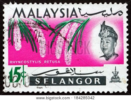 MALAYSIA - CIRCA 1965: a stamp printed in Malaysia shows Foxtail Orchid Rhyncostylis Retusa Orchid Flower circa 1965