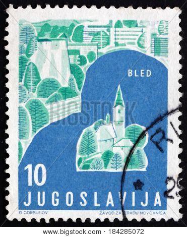 YUGOSLAVIA - CIRCA 1959: a stamp printed in Yugoslavia shows Bled Slovenia Tourist Attractions circa 1959