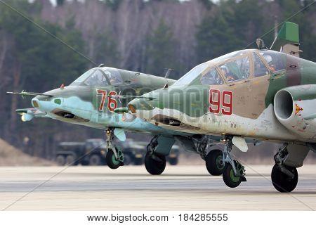 KUBINKA, MOSCOW REGION, RUSSIA - APRIL 10, 2017: Sukhoi Su-25 attack aircrafts of Russian air force landing during Victory Day parade rehearsal at Kubinka air force base.