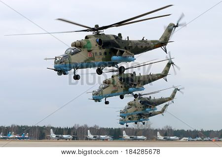 KUBINKA, MOSCOW REGION, RUSSIA - APRIL 10, 2017: Mil Mi-35M RF-13027 attack helicopters of Russian air force during Victory Day parade rehearsal at Kubinka air force base.
