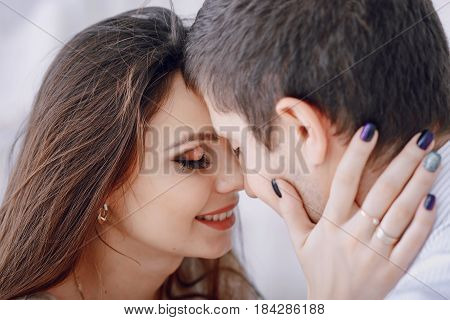 beautiful couple in love on a white background at home