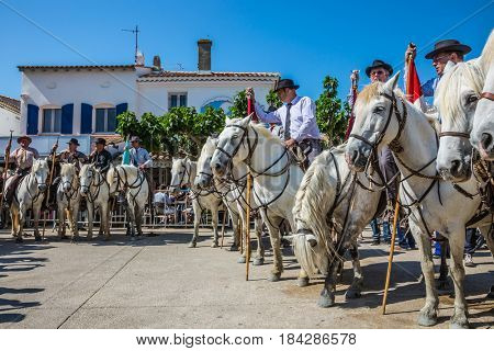 Sent-Mari-de-la-Mer, Provence, France - May 25, 2015. Guards on white horses before the start of the parade. The concept of active and ethnographic tourism. World Festival of Gypsies