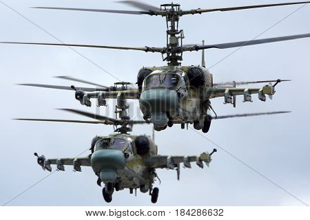 KUBINKA, MOSCOW REGION, RUSSIA - APRIL 24, 2017: Pair of Kamov Ka-52 Alligator attack helicopters of Russian air force during Victory Day parade rehearsal at Kubinka air force base.