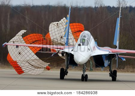 KUBINKA, MOSCOW REGION, RUSSIA - APRIL 24, 2017: Sukhoi Su-30SM 34 BLUE Russian Knights aerobatics team of Russian air force during Victory Day parade rehearsal at Kubinka air force base.