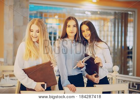 three beautiful business girl  in the restaurant