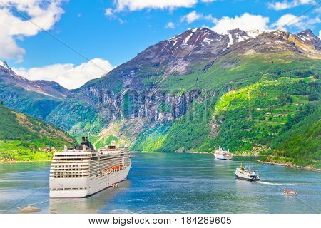 a cruise ship in the norwegian fjiord