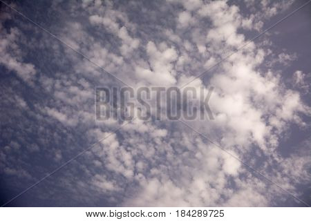Fluffy clouds in a blue sky sunny day